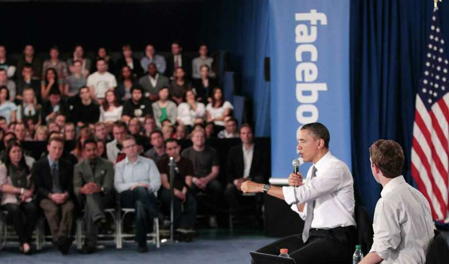 President Barack Obama and Facebook CEO Mark Zuckerberg take part in a town hall meeting to discuss reducing the national debt, Wednesday, April 20, 2011, at Facebook headquarters in Palo Alto, Calif. Photo: AP