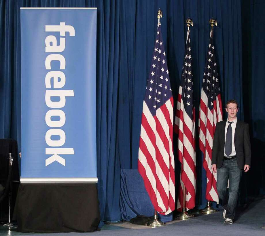 Facebook CEO Mark Zuckerberg is introduced for a town hall meeting, with President Barack Obama, to discuss reducing the national debt, Wednesday, April 20, 2011, at Facebook headquarters in Palo Alto, Calif. Photo: AP