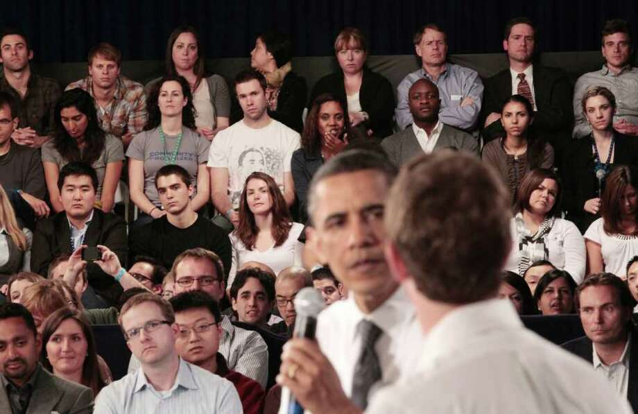Members of the audience listen to President Barack Obama and Facebook CEO Mark Zuckerberg during a town hall meeting to discuss reducing the national debt, Wednesday, April 20, 2011, at Facebook headquarters in Palo Alto, Calif. Photo: AP