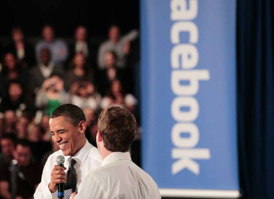 President Barack Obama laughs with Facebook CEO Mark Zuckerberg during a town hall meeting to discuss reducing the national debt, Wednesday, April 20, 2011, at Facebook headquarters in Palo Alto, Calif., . Photo: AP
