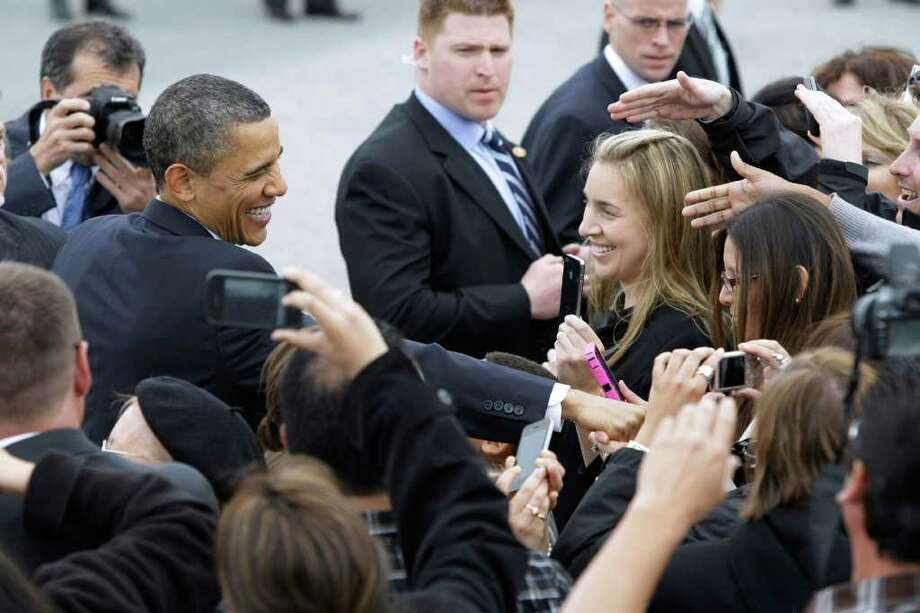 President Obama shake hands as he arrives at San Francisco International Airport in San Francisco, Wednesday, April 20, 2011, for a planned meeting at Facebook headquarters. Photo: AP
