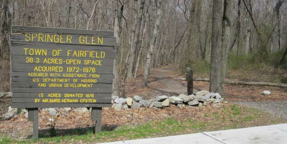 Fairfield has about 50 open spaces comprising woods and fields preserved for recreation or communing with nature. They are marked by rustic, wood signs such as this one at Springer Glen, which is accessible off Stillson Road. Photo: Contributed Photo / Fairfield Citizen contributed