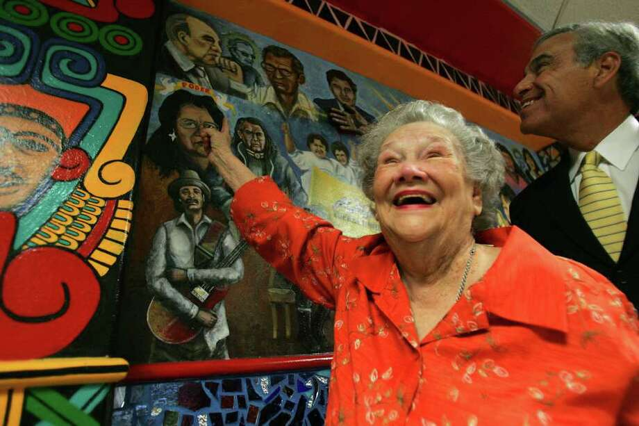 "Bertha Gonzalez, widow of the late U.S. Rep. Henry B. Gonzalez, looks at her husband portrait during  the San Antonio College and San Anto Cultural Arts unveiling of the mural/mosaic, ""Everything for Everyone...Nothing for Ourselves,"" on Monday, Oct. 3, 2005. With her is her son, U.S. Rep. Charlie Gonzalez.  Photo: JERRY LARA, SAN ANTONIO EXPRESS-NEWS / SAN ANTONIO EXPRESS-NEWS"