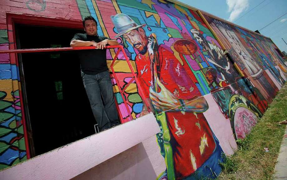 """Local artist David Blancas is working on a nearly 150-feet wide mural called """"La Musica de San Anto"""" on the city's West side that depicts some of the city's iconc of music. Among the musical artists are: Randy Garibay, Clifford Scott, Rocky Morales, Felix Villarreal, Manny Castillo, Eva Garza, Doug Sahm, Lydia Mendoza and Guadalupe and Aurora Olguin.  Photo: KIN MAN HUI, San Antonio Express-News / kmhui@express-news.net"""