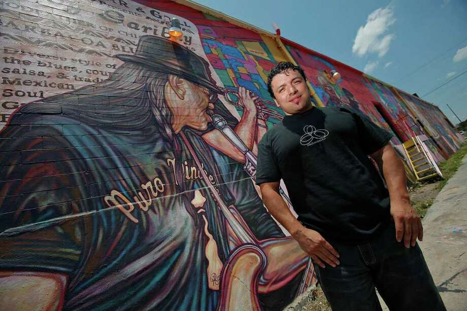 "Local artis David Blancas is working on a nearly 150-feet wide mural called ""La Musica de San Anto"" on the city's West side that depicts some of the city's icons of music. Among the musical artists are: Randy Garibay, Clifford Scott, Rocky Morales, Felix Villareal, Manny Castillo, Eva Garza, Doug Sahm, Lydia Mendoza and Guadalupe and Aurora Olguin. Blancas started the mural in September 2008 and expected to be completed by October 2009. Photo: KIN MAN HUI, San Antonio Express-News / kmhui@express-news.net"