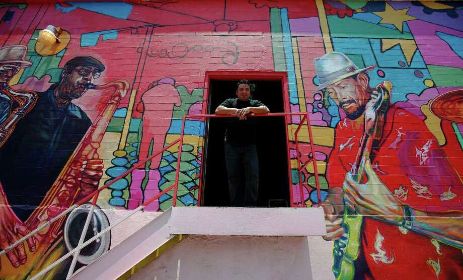 """Local artis David Blancas is working on a nearly 150-feet wide mural called """"La Musica de San Anto"""" on the city's West side that depicts some of the city's icons of music. Among the musical artists are: Randy Garibay, Clifford Scott, Rocky Morales, Felix Villareal, Manny Castillo, Eva Garza, Doug Sahm, Lydia Mendoza and Guadalupe and Aurora Olguin.  Photo: KIN MAN HUI, San Antonio Express-News / kmhui@express-news.net"""