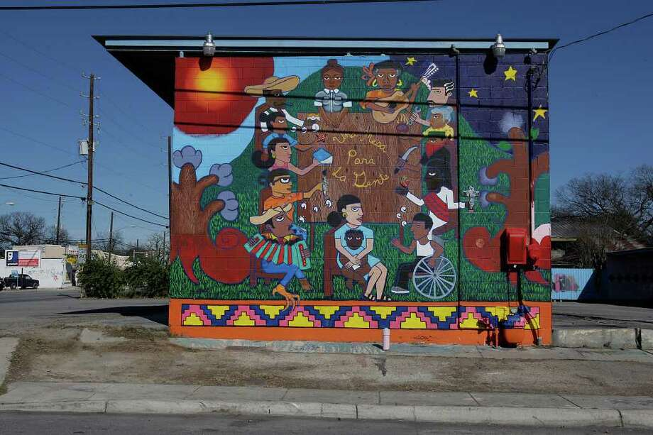 """Una Mesa Para La Gente,"" is a mural done by San Anto Cultural Arts and is located at the corner of North Zarzamora and West Salinas St. on Tuesday, Jan. 6, 2009. Photo: JERRY LARA, SAN ANTONIO EXPRESS-NEWS / glara@express-news.net"