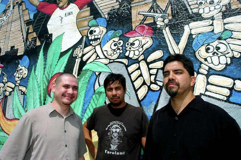 Juan Ramos (from left), Cruz Ortiz, and Manuel Castillo stand in front of a mural painted by Ramos and Ortiz. The mural is located at the corner of Chupaderas and Guadalupe Sts. When it was first painted the people living in the surrounding neighborhood reacted so favorably that Castillo decided to start San Anto, a cultural arts center. Castillo is now the executive director of San Anto Cultural Arts. Photo: MIKE KANE, SAN ANTONIO EXPRESS-NEWS / SAN ANTONIO EXPRESS-NEWS