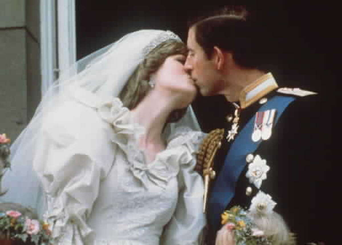 Britain's Prince and Princess of Wales kiss on the balcony of Buckingham Palace in London after their wedding in this July 29, 1981, file photo. The two were divorced in 1996. Prince Edward, the youngest of four children of Queen Elizabeth II and Prince Philip, marries Sophie Rhys-Jones on June 19, 1999. (AP Photo/FILE)