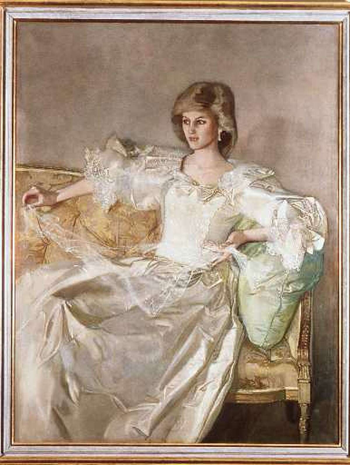 A previously unseen portrait of Princess Diana in her wedding dress, which is among paintings in a private collection that Prince Charles has lent for an exhibition of works collected by himself and four previous holders of the title of Prince of Wales. The portrait, by artist John Ward, shows the late princess posing at Kensington Palace in 1984. It is among 300 works of art and craft taken from the royal family's palaces and other homes which will be on display at the Museum of Wales in Cardiff. (AP Photo/HO).
