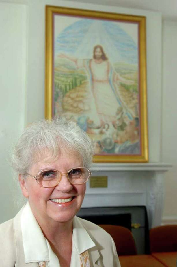 """Diane Wyckoff, of Bridgeport, stands in front of """"Jesus, the Sermon on the Mount"""" , a six-foot pencil and pastel drawing that she recently donated to St. John's Episcopal Church, in Bridgeport, Conn. April 21st, 2011. Photo: Ned Gerard / Connecticut Post"""