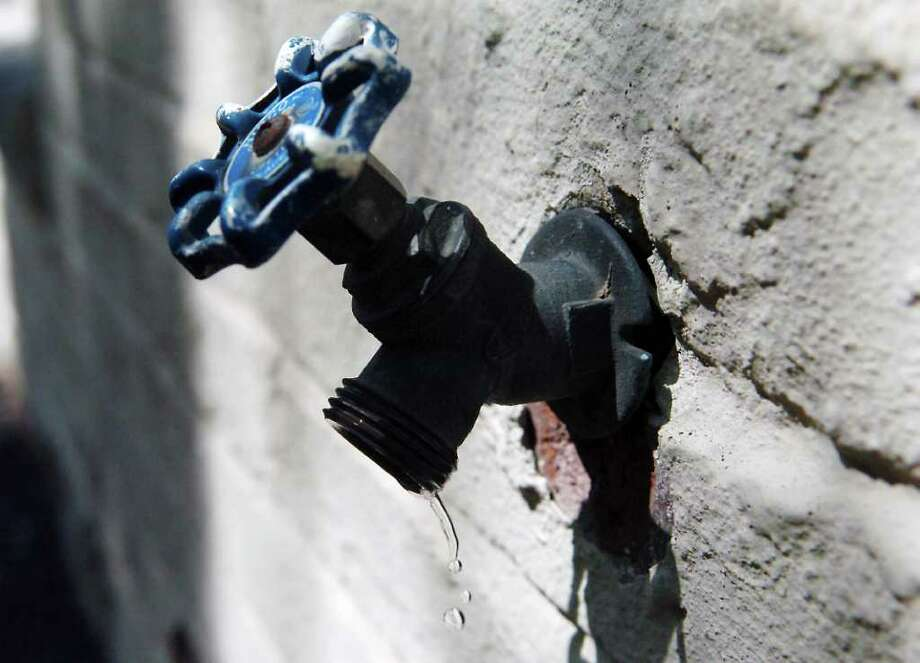 Fixing leaky faucets is one way to conserve water in Stamford, Conn. on Thursday April 21, 2011. Photo: Kathleen O'Rourke / Stamford Advocate