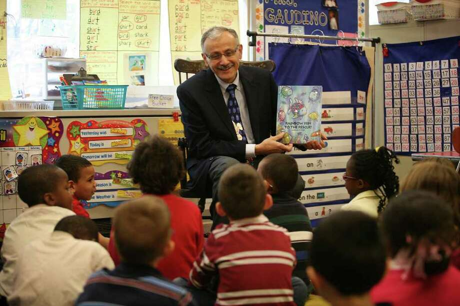 Principal Lawrence DiPalma reads to Chera Gaudino's first grade class at Prendergast School in Ansonia on Tuesday, April 19, 2011. DiPalma was recently selected as the Connecticut winner of the National Distinguished Principal Award. Photo: Brian A. Pounds / Connecticut Post