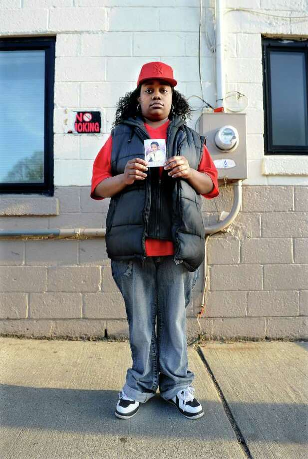 Tanya McDowell stands outside the Norwalk Emergency Shelter with a photo of her son, A.J. Paches, on Wednesday, April 20, 2011. McDowell, who is homeless and lives in her van, was arrested after enrolling her son in the Norwalk City School District. Photo: Lindsay Niegelberg / Connecticut Post