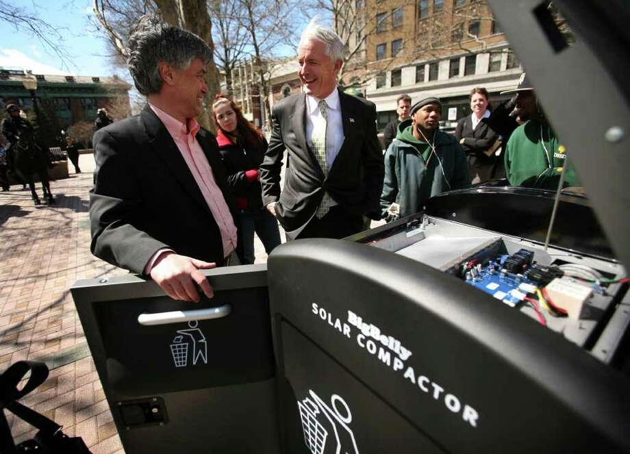 Rick Gaudett, left, director of sales for Big Belly Solar, shows Bridgeport Mayor Bill Finch a Big Belly Solar Compactor trash bin installed on McLevy Green in downtown Bridgeport on Thursday, April 21, 2011. Photo: Brian A. Pounds / Connecticut Post
