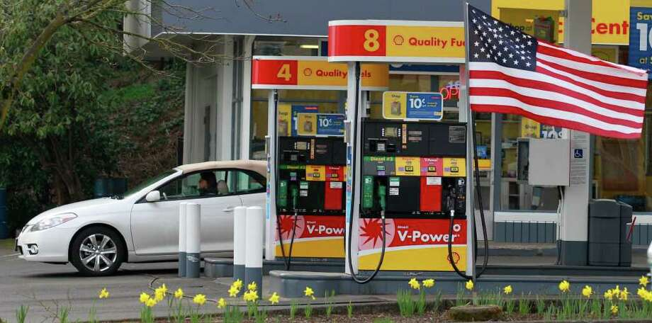 In this April 12, 2011 photo. a gas station is shown in Portland, Ore. A private research group said U.S. economic growth should strengthen by summer, but consumer concerns about rising oil and food prices could drag on the expansion.  (AP Photo/Rick Bowmer) Photo: Rick Bowmer
