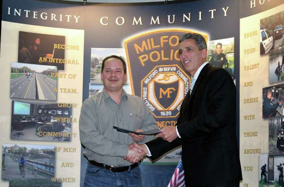 Contributed Photo\Nancy Juliano Steven Daniels accepts his certificate from Chief Keith Mello during Wednesday night's graduation ceremony for the Citizens Police Academy, offered annually by the Milford police. Photo: Contributed Photo/Nancy Juliano, Contributed Photo\Nancy Juliano / Connecticut Post Contributed/Nancy Juliano
