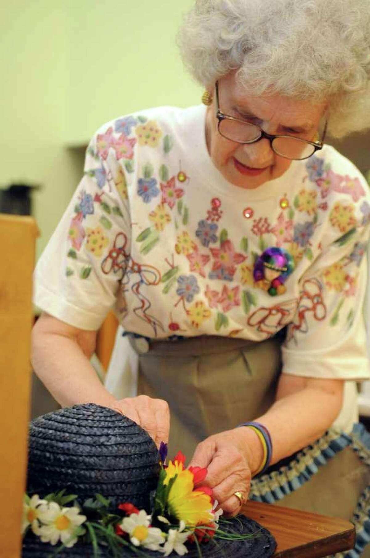 Sarah Masso adorns a bonnet during a demostration Thursday, April 21, 2011 at the Baldwin Center in Stratford, Conn.