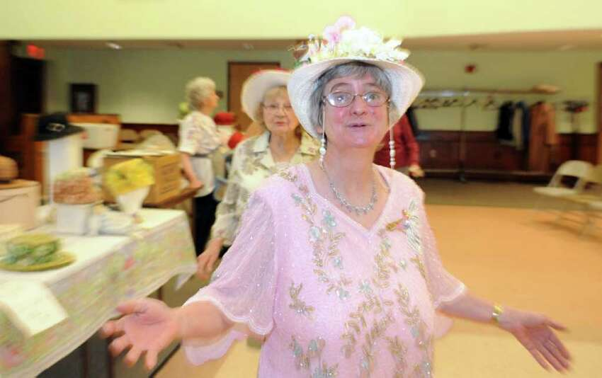 Shirley Backus sings along during the Easter Bonnet Parade Thursday, April 21, 2011 at the Baldwin Center in Stratford, Conn.