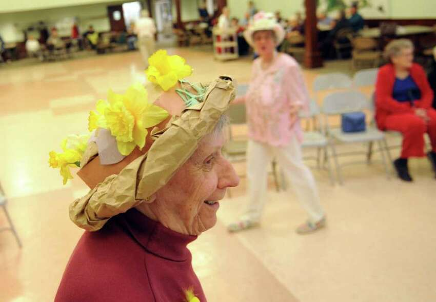 Millie Napolitano marches in the Easter Bonnet Parade Thursday, April 21, 2011 at the Baldwin Center in Stratford, Conn.