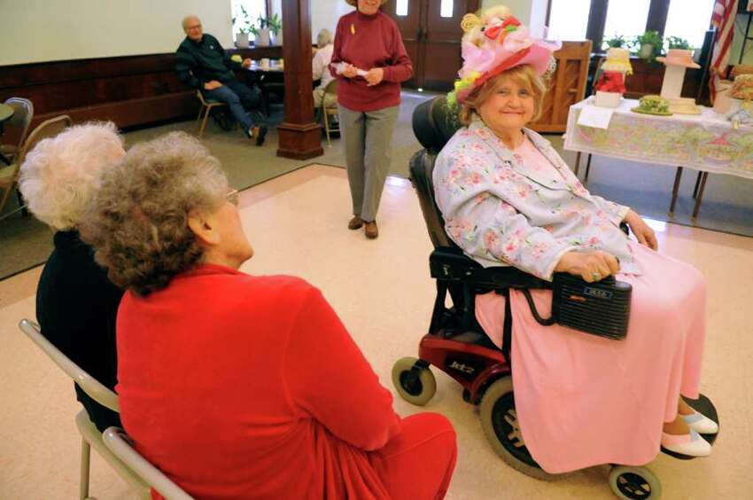 Marge Reed marches in the Easter Bonnet Parade Thursday, April 21, 2011 at the Baldwin Center in Stratford, Conn.
