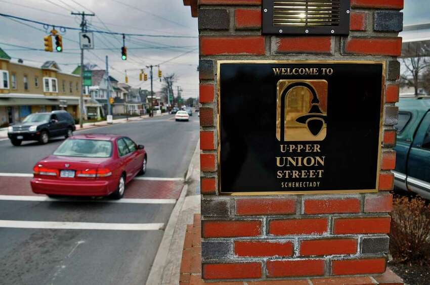 The Upper Union Street area of Schenectady includes quiet residential streets that lead to a thriving commercial strip. In a recent National Association of Realtors survey, a majority of Americans said they would prefer to live in neighborhoods where they can walk to stores. (Philip Kamrass / Times Union)