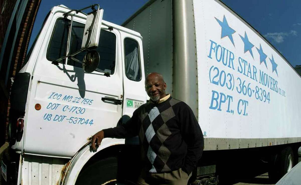 Willie Quarles, who owns and operates Four Star Moving Company, poses with one of the trucks in his fleet at his operation along Connecticut Avenue in Bridgeport, Conn. on Thursday April 21, 2011.