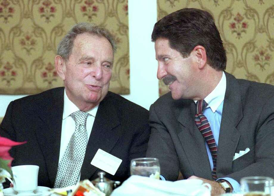 Seymour Powers , left, winner of the Previdi Award in 1999, and then-Mayor Eriquez speak together at a luncheon held at the Ridgewood Country. Mayor Eriquez presented the award to Powers. Photo: Carol Kaliff / The News-Times