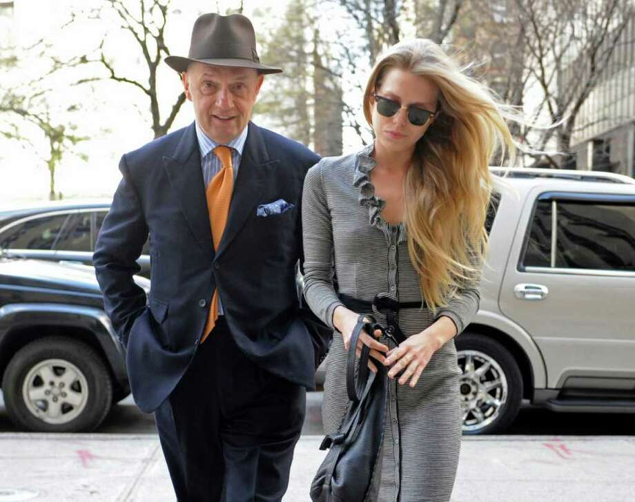 Theodora Richards, daughter of Rolling Stones guitarist Keith Richards, enters Manhattan Criminal Court with her attorney Edward Hayes, Thursday, April 21, 2011, in New York. A judge agreed to dismiss her graffiti and drug possession charge for two days of community service and visiting a drug treatment program for a day. (AP Photo/Louis Lanzano) Photo: Louis Lanzano