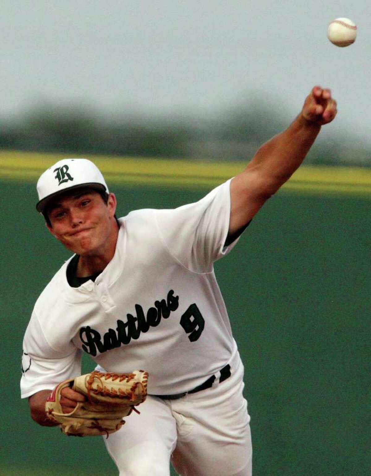 FOR SPORTS - Reagan's Matt McClain pitches against Johnson Thursday April 21, 2011 at Blossom baseball field. (PHOTO BY EDWARD A. ORNELAS/eaornelas@express-news.net)