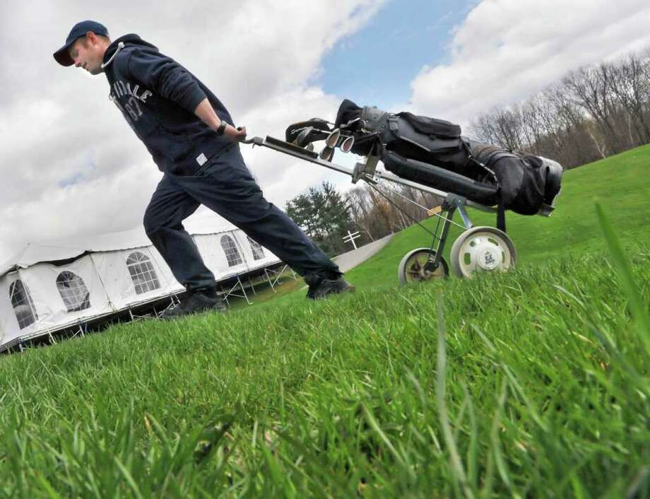 Matt Janowski of Rensselaer finishes up a round of golf at Capitol Hills Golf Course in Albany Thursday afternoon April 21, 2011.  (John Carl D'Annibale / Times Union) Photo: John Carl D'Annibale / 00012881A