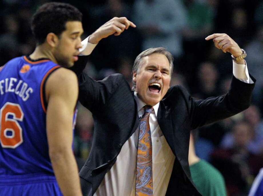New York Knicks coach Mike D'Antoni yells to a referee as Knicks guard Landry Fields (6) stands nearby during the first half against the Boston Celtics in Game 2 of a first-round NBA basketball playoff series, in Boston on Tuesday, April 19, 2011. (AP Photo/Elise Amendola) Photo: Elise Amendola