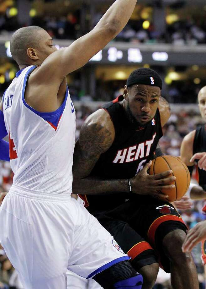 Philadelphia 76ers' Tony Battie, left, defends as Miami Heat's LeBron James drives to the basket during the first half of Game 3 of a first-round NBA playoff basketball series, Thursday, April 21, 2011, in Philadelphia. (AP Photo/Tom Mihalek) Photo: Tom Mihalek