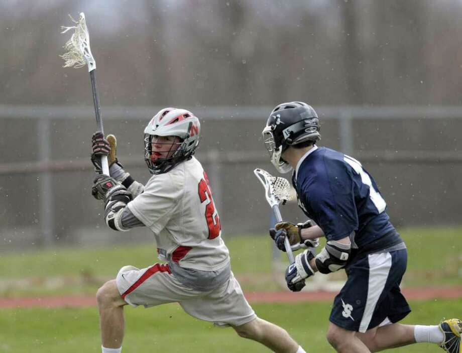 High school lacrosse -- Blake Pfohl, left, of Niskayuna High School winds up for a shot on goal as a  Saratoga defender chases him during their lacrosse game on Thursday afternoon, April 21, 2011 at Niskayuna High School in Niskayuna.  (Paul Buckowski / Times Union) Photo: Paul Buckowski / 00012845A