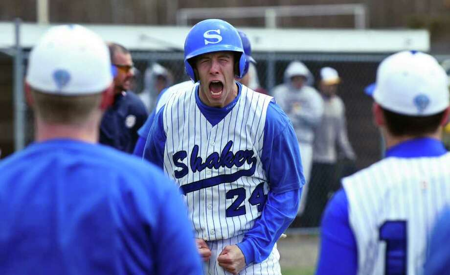Shaker High School's Drew Lasky celebrates after scoring the game tying run in the bottom of the seventh inning of their dramatic, come from behind win over Colonie  on Thursday April 21, 2011 in Latham, NY.  Shaker won 4-3 wth a two out , two run, come from behind rally in the bottom of the seventh inning.  ( Philip Kamrass / Times Union ) Photo: Philip Kamrass