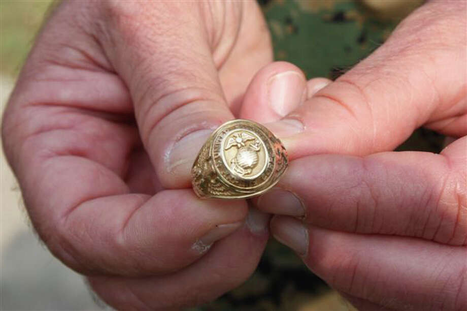 Glen Cleckler shows the ring given him by Harlon Block, who helped raise the flag on Iwo Jima. Photo: Courtesy Photo/Marine Military Academy
