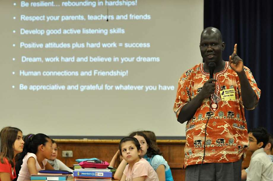 Sixth graders at Hillcrest Middle School in Trumbull listen as Gabriel Bol Deng, Founder and Director of Hope for Ariang, speaks about his dream of enhancing education in his village. Photo: Amy Mortensen / Connecticut Post