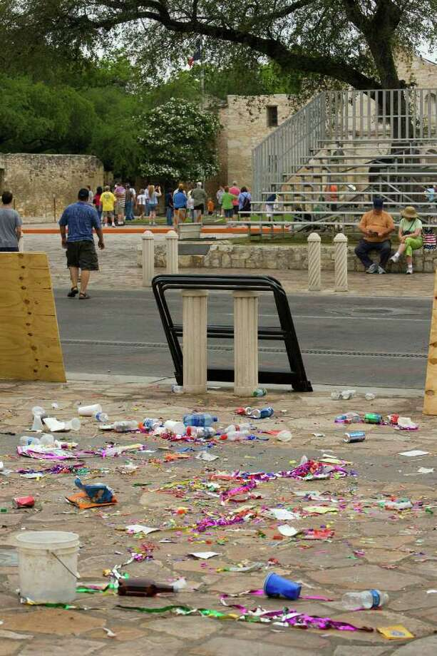 Garbage left in Alamo Plaza. After the two Fiesta street parades this year, the city collected a record 11.96 tons of recyclable materials. Photo: Gary L. Foreman/Special To The Express-News / GARY L. FOREMAN /COURTESY