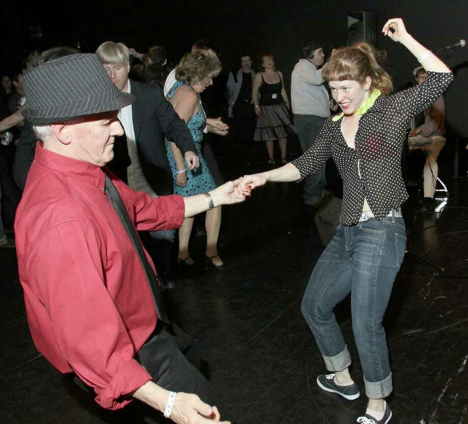 Paul Walley, pastor of St. Paul?s Evangelical Lutheran Church, and Laura Teeter, a dancer with Ellen Sinopoli Dance Company, swing to the music of The Tichy Boys during River Street Riot, a rockabilly dance party to benefit The Arts Center of the Capital Region, a nonprofit regional arts organization in Troy. (Photo by Joe Putrock / Special to the Times Union) Photo: Joe Putrock / Joe Putrock