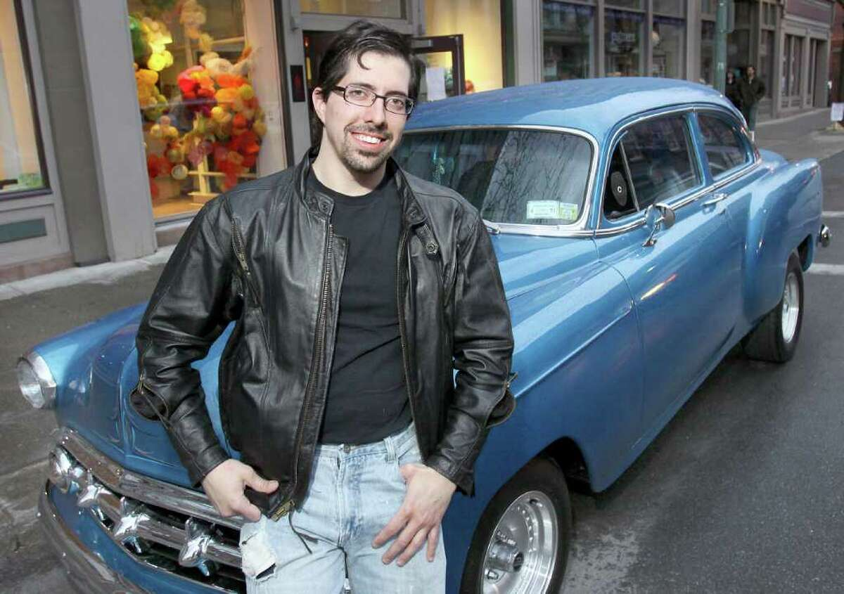Tony Iadicicco, the creative director for Albany Center Gallery, parked his ?53 Chevy Bel Air on River Street during the benefit. (Photo by Joe Putrock / Special to the Times Union)