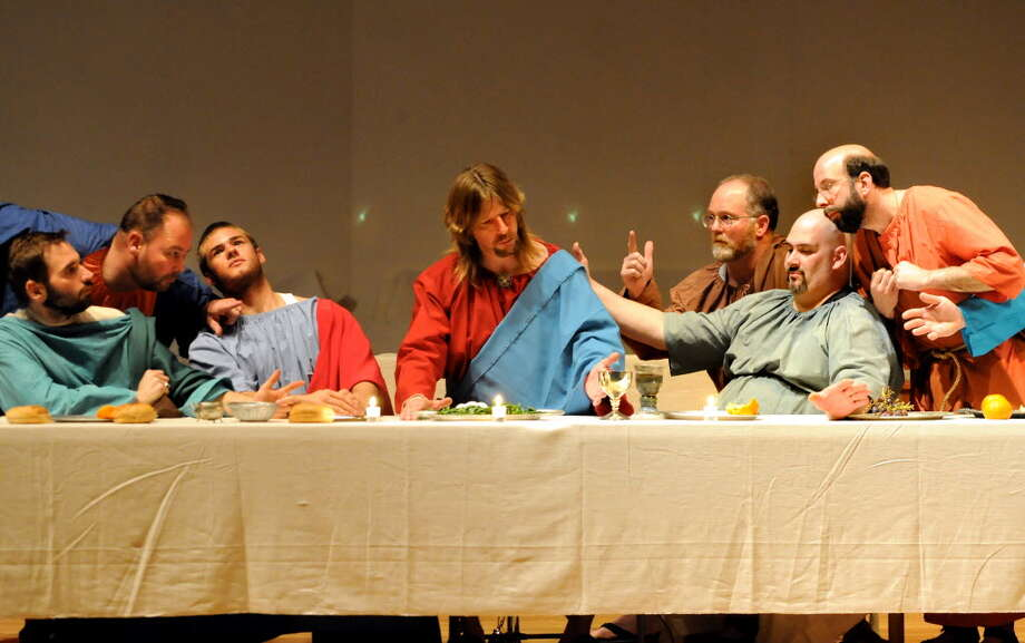 Jesus Christ, played by Robert Dahoda, center, and his 12 disciples pose to resemble Leonardo Da Vinci?s painting of the Last Supper during Maundy Thursday service at Shenendehowa United Methodist Church in Clifton Park. (Cindy Schultz / Times Union)