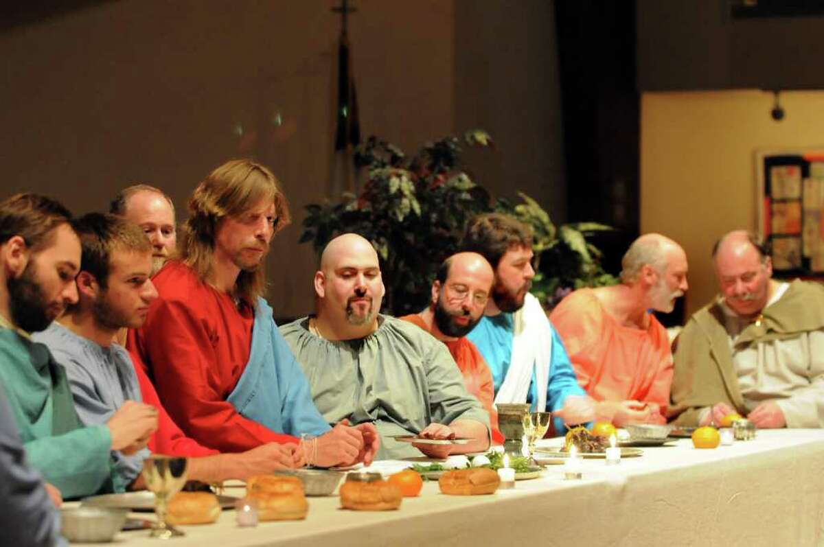 Jesus Christ, played by Robert Dahoda, fourth from left, and his 12 disciples pose to resemble Leonardo Da Vinci's painting of the Last Supper during Maundy Thursday Service on Thursday, April 21, 2011, at Shenendehowa United Methodist Church in Clifton Park, N.Y. (Cindy Schultz / Times Union)