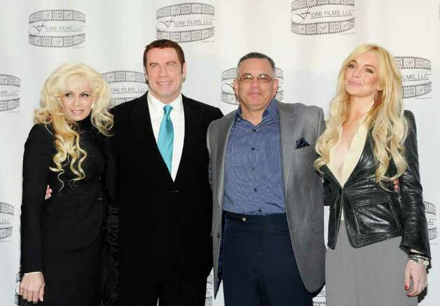 "FILE - In this April 12, 2011 file photo, Victoria Gotti, author and daughter of the late John Gotti, left, actor John Travolta, John Gotti Jr. and actress Lindsay Lohan pose during a news conference for the film ""Gotti: Three Generations"", based on the life of John Gotti in New York. Lohan is joining the big screen Gotti family as the wife of John Gotti Jr. in a biopic of one of New York's most infamous families. She called her casting in ""Gotti: Three Generations"" a huge honor and told The Associated Press on Wednesday that the film is an opportunity to prove herself as an actress again. Photo: AP"