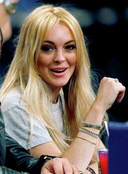 FILE - In this Jan. 9, 2011 file photo, actress  Lindsay Lohan is shown at an NBA basketball game between the Los Angeles Laker and the New York Knicks in Los Angeles. Authorities released the 911 call made by Dawn Holland, a Betty Ford Center worker claiming that Lindsay Lohan hit her during a December argument at the facility. Photo: AP
