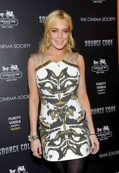 "Actress Lindsay Lohan attends a screening of ""Source Code"" hosted by the Cinema Society at the Crosby Street Hotel on Thursday, March 31, 2011 in New York. Photo: AP"