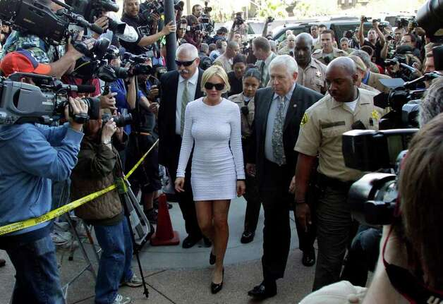 Actress Lindsay Lohan, center, arrives at the LAX Airport Courthouse in Los Angeles, Wednesday, Feb. 9, 2011, to be arraigned on a felony grand theft charge that prosecutors say they will file over a $2,500 necklace reported stolen by an upscale jewelry store. Photo: AP