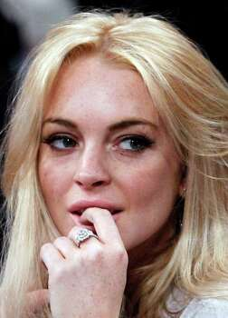 FILE - In this Jan. 9, 2011 file photo, Lindsay Lohan attends the Los Angeles Lakers New York Knicks NBA basketball game in Los Angeles. Photo: AP