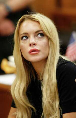 FILE - In this July 6, 2010 file photo, actress Lindsay Lohan appears in a courtroom for a probation revocation hearing in Beverly Hills, Calif. Lohan is scheduled to turn herself in Tuesday, July 20, to begin serving a 90 day jail sentence for violating the terms of her probation for a 2007 drug case. Photo: AP