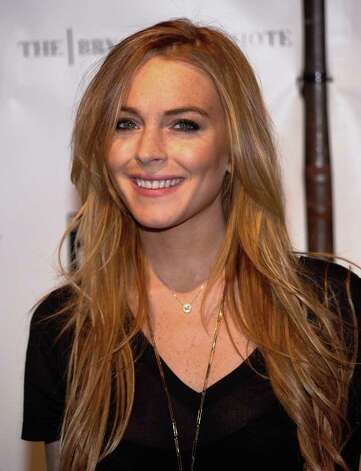 ** FILE **In this Thursday, Oct. 30, 2008, file photo, Actress Lindsay Lohan attends FEARnet's 2nd anniversary party at The Cellar Bar, in New York. Beverly Hills police say an arrest warrant has been issued for Lohan and they believe it involves her 2007 drunken driving conviction. Police Sgt. Mike Foxen said Saturday, March 14, 2009, that a court issued the warrant on Friday but he said he didn't have any details. Photo: Evan Agostini, AP / AGOEV