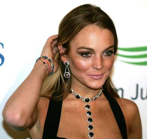 U.S. actress Lindsay Lohan arrives on the red carpet at the Atlantis hotel grand opening on Jumeirah Palm Island in Dubai, United Arab Emirates, Thursday, Nov. 20, 2008. Photo: Kamran Jebreili, AP / AP